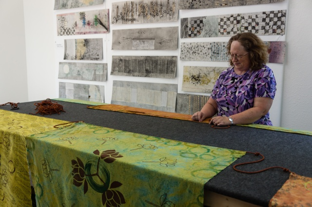 Deb Taylor working in Jane Dunnewold's San Antonio studio, assisting with Sharon Rowley's Prayer Flag installation, 2013