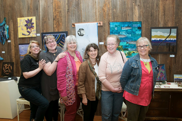 Some Members of Fiber19, a fiber group that meets monthly, at a show of Fiber19 work at the Sydney Art Gallery in port orchard, wa: Tre Taylor, Becky Wachtman, Louise Roby, Mary Auld, Deb Taylor, Barbara Matthews