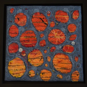 """Frayed Holes"" by Deb Taylor - 2015. Chambray fabric, painted cotton batting, screen printing, quilting, beads. The work is a later addition to the Fiber 19 group Beyond Blue collaborative project."